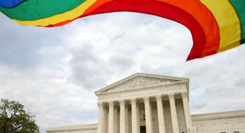 A rainbow colored flag flies in front of the Supreme Court in Washington, Monday, April 27, 2015, as the Supreme Court is scheduled to hear arguments on the constitutionality of state bans on same-sex marriage on Tuesday. (AP Photo/Andrew Harnik)